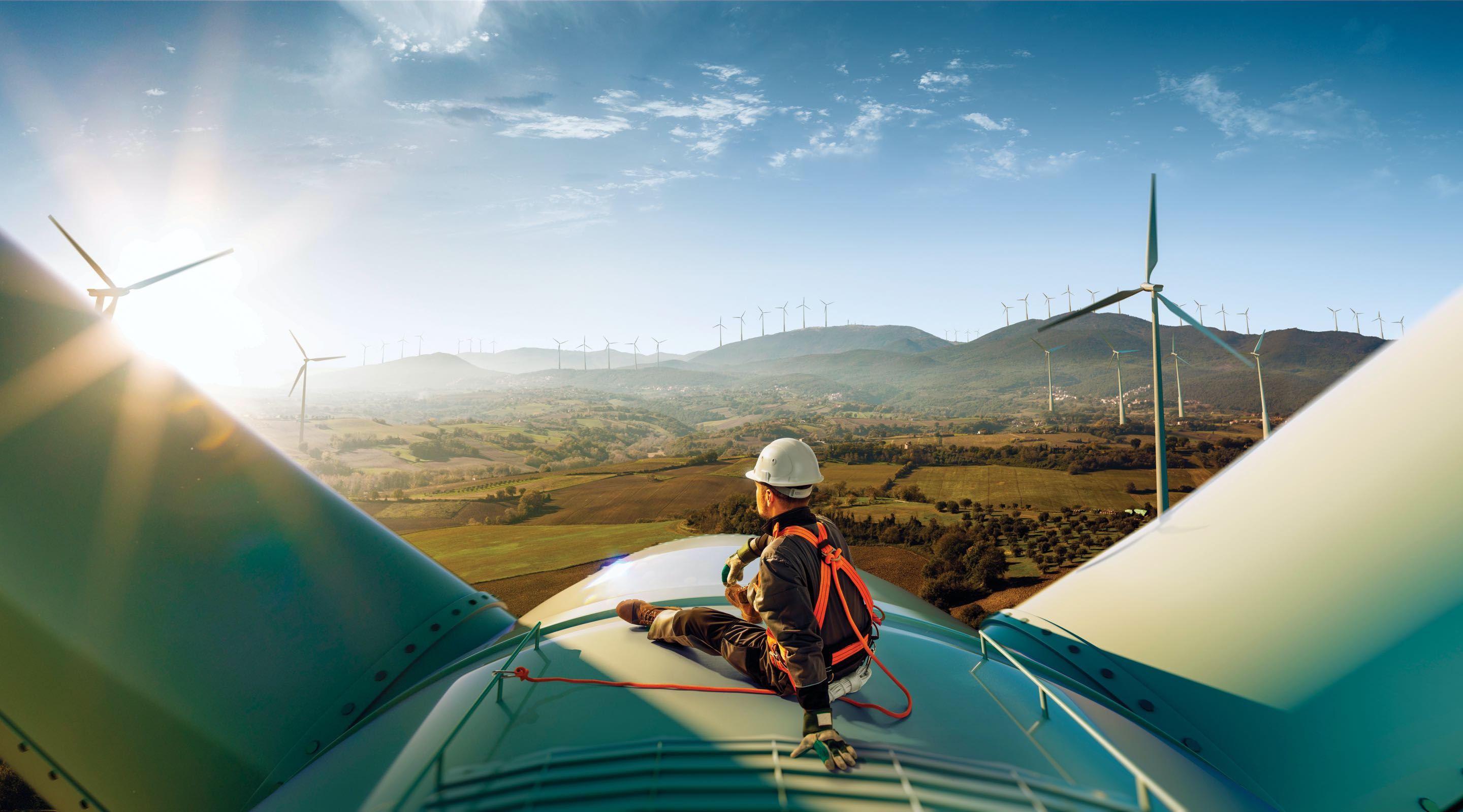 Technician sitting on wind turbine